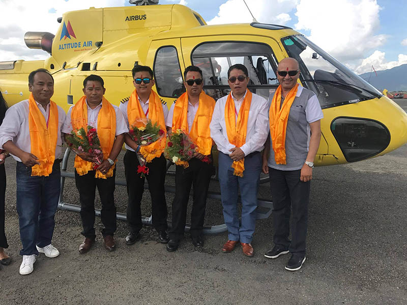 Crew and board of directors of Altitude Air with newly brought Airbus helicopter at TIA in Kathmandu on Saturday, September 2, 2017. Courtesy: Altitude Air