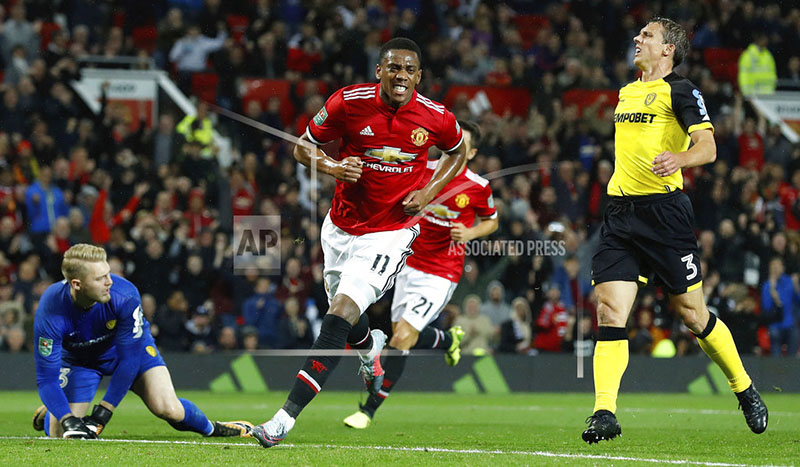 Manchester United's Anthony Martial celebrates scoring his side's fourth goal of the game against Burton Albion, during their English League Cup soccer match at Old Trafford in Manchester, England, Wednesday Sept. 20, 2017. Photo: AP