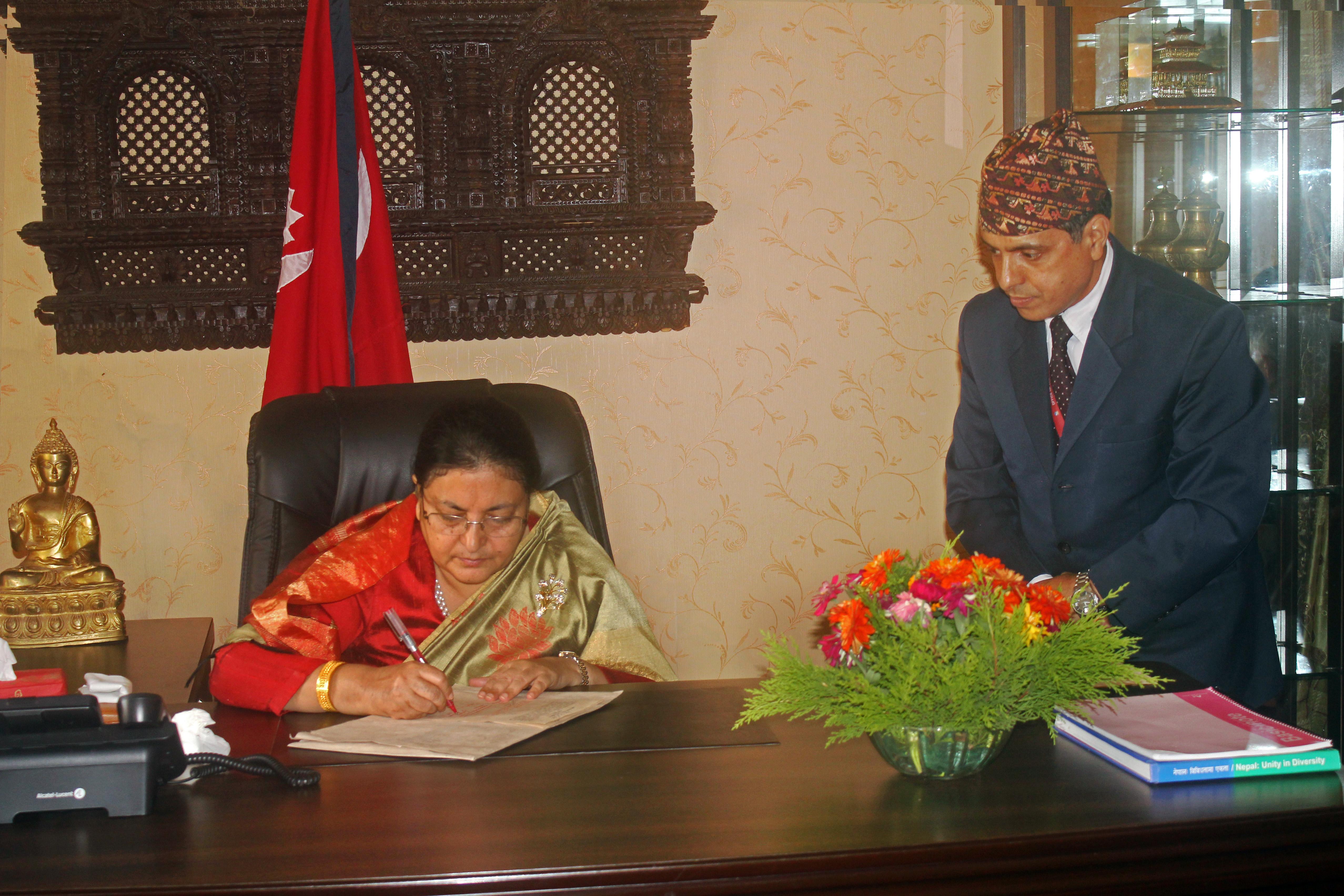 President Bidya Devi Bhandari authenticates Bill of Election of Members of House of Representatives and Election of Members of Provincial Assembly in Kathmandu, on Thursday, September 7, 2017. Photo: President's Office