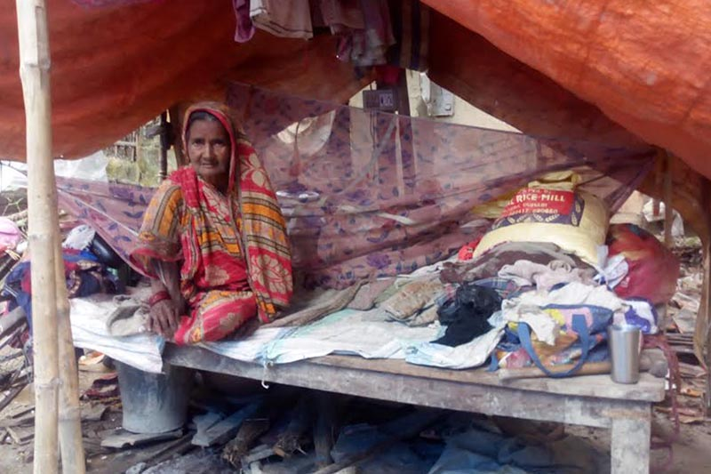 Flood victim Ram Kumari Devi Mandal, 70, sitting inside a makeshift tent after her house was swept away in floods, in Biratnagar Metropolitan City, Morang, on Monday, September 4, 2017. Photo: THT