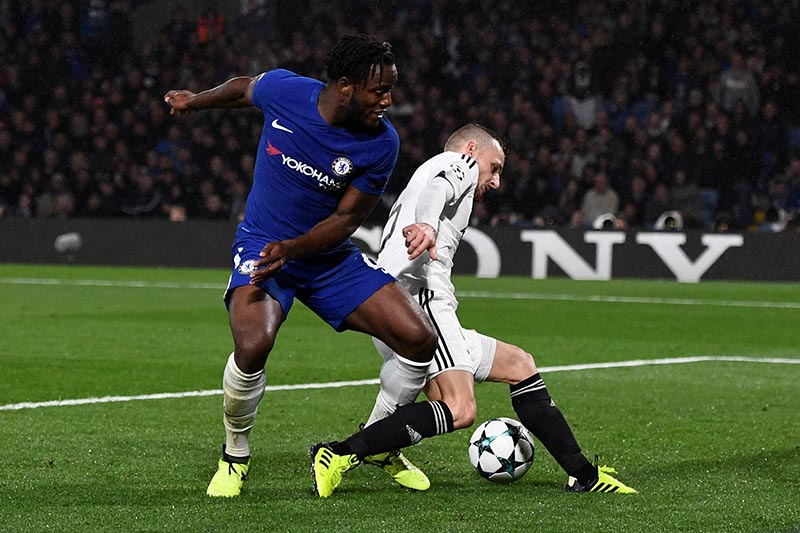Chelsea's Michy Batshuayi in action with Qarabagu2019s Maksim Medvedev who scores an own goal for the sixth goal during the Champions League match between Chelsea and Qarabag FK, in Stamford Bridge, London, Britain, on September 12, 2017. Photo: Reuters
