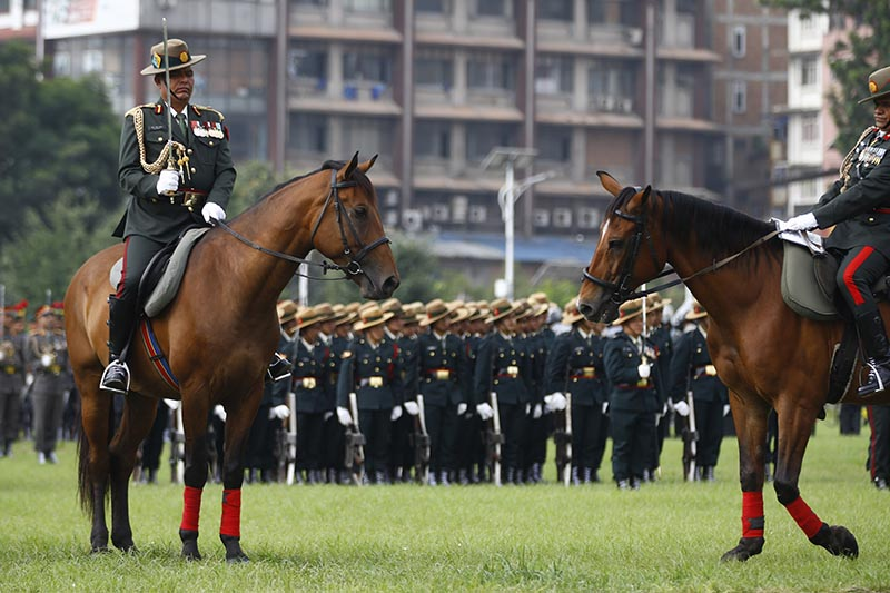 Nepali  Army Soldiers parade on horses during celebration held to mark Nepalu2019s Constitution Day at the Army Pavilion in Kathmandu, Nepal on Tuesday, September 19, 2017. Photo: Skanda Gautam