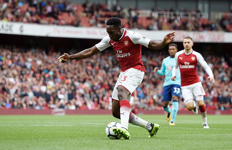 Arsenal's Danny Welbeck scores their third goal. Photo: Reuters
