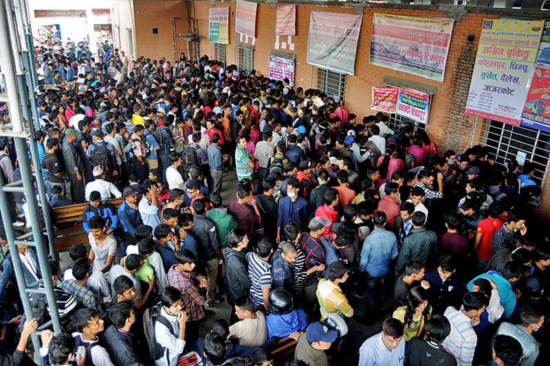 FILE - People wait in queue to book tickets in advance for Dashain holidays at New Bus park, in Gongabu, Kathmandu, on Tuesday, September 12, 2017. Photo: Bal Krishna Thapa Chhetri