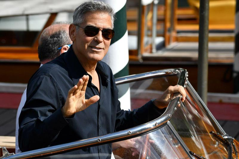 Actor George Clooney waves to photographers as he arrives on a motorboat during the 74th edition of the Venice Film Festival, in Venice, Italy,on  Saturday, September 2, 2017. Photo: Ettore Ferrari/ANSA via AP