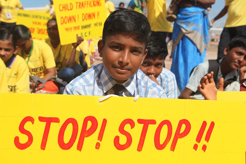 A schoolboy holds a sign calling for end of child trafficking and sex abuse at an event to kick off what is expected to be the world's largest march against such crimes in Kanyakumari in India's Tamil Nadu state, on September11, 2017. Photo: Reuters