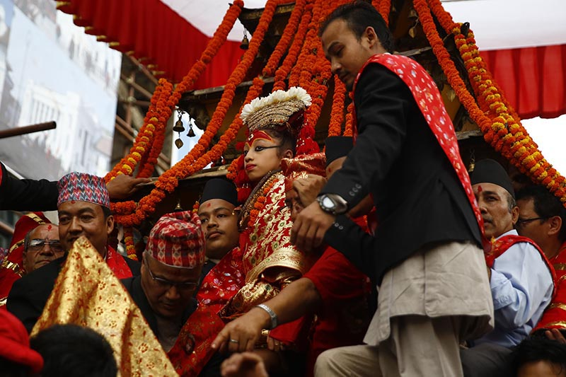 A devotee carrying living goddess Kumari (centre) to a chariot during Indra Jatra, in Kathmandu, on Tuesday, September 5, 2017. The festival marks the end of rainy season. Photo: THT