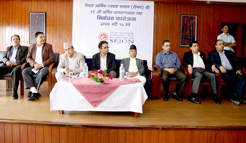 Finance Minister Gyanendra Bahadur Karki (centre right)  and Nepal Rastra Bank Governor Dr Chiranjibi Nepal (centre left) at the18th annual assembly of the Society of Economic Journalists Nepal (Sejon), in Kathmandu, on Friday, September 1, 2017. Photo: RSS