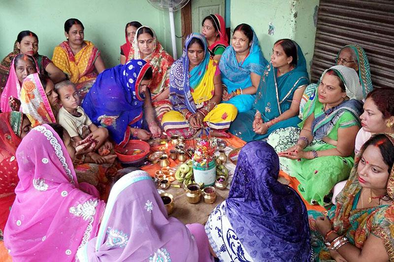 File - Women offering prayers on the occasion of Jitiya Festival in Birgunj, on Wednesday, September 13, 2017. Photo: Ram Sarraf