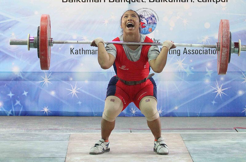 Kamala Shrestha of Tribhuvan Army Club lifts weight during the Sunil Lal Joshi Memorial Weightlifting Championship in  Lalitpur on Wednesday, September 13, 2017. Photo: Udipt Singh Chhetry/THT