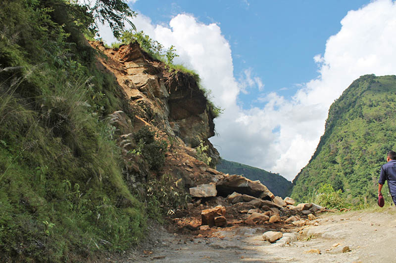 Police is seen walking along the Chame-Besishar road section, blocked by landslide at Arghale in Lamjung district, on Monday, September 4, 2017. Photo: Ramji Rana