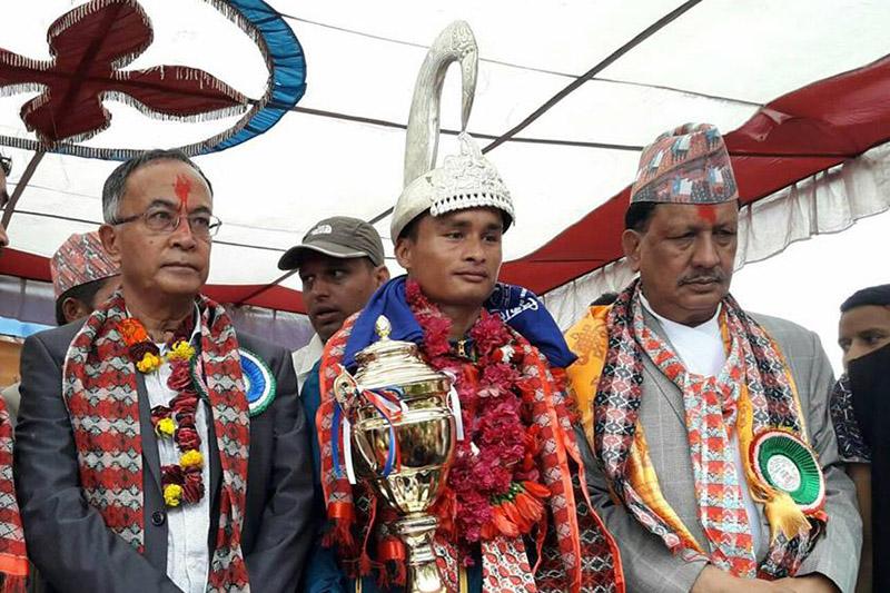 Nepali Army Rajendra Bahadur Bhatta pose after winning the Liglige race in Gorkha district, on Monday, September 25, 2017. Photo: Ramji Rana