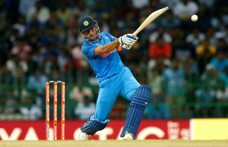MS Dhoni of India hits a boundary. Photo: Reuters