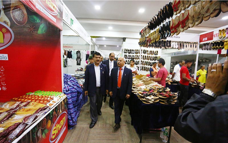 Minister for Commerce Min Bahadur Bishwakarma observing products on display at the Eighth Made in Pakistan Exhibition, in Kathmandu, on Wednesday, September 13, 2017. Photo: THT