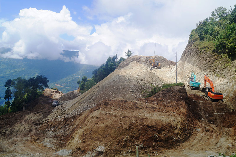 Excavators being used for the construction of Aathrai road strech along Mid-Hilly Highway in Terathum district, on Monday, September 11, 2017. Photo: RSS
