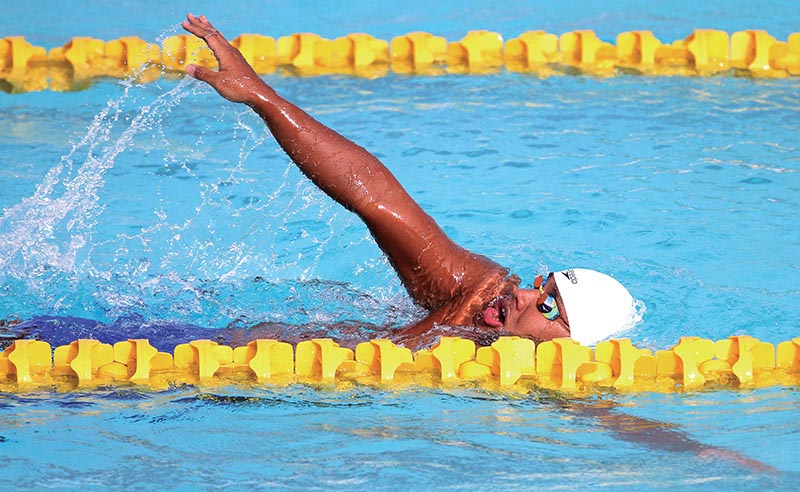 Sirish Gurung of Tribhuvan Army Club swims during the menu2019s 50m backstroke event of the NSA Cup Swimming Championship at the International Sports Complex in Lalitpur, on Tuesday. Photo: THT