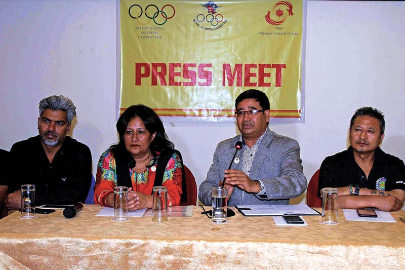 Nepal Olympic Committee President Jeevan Ram Shrestha speaks as vice-president Jyoti Rana looks on during a press meet in Kathmandu on Monday. Photo: THT