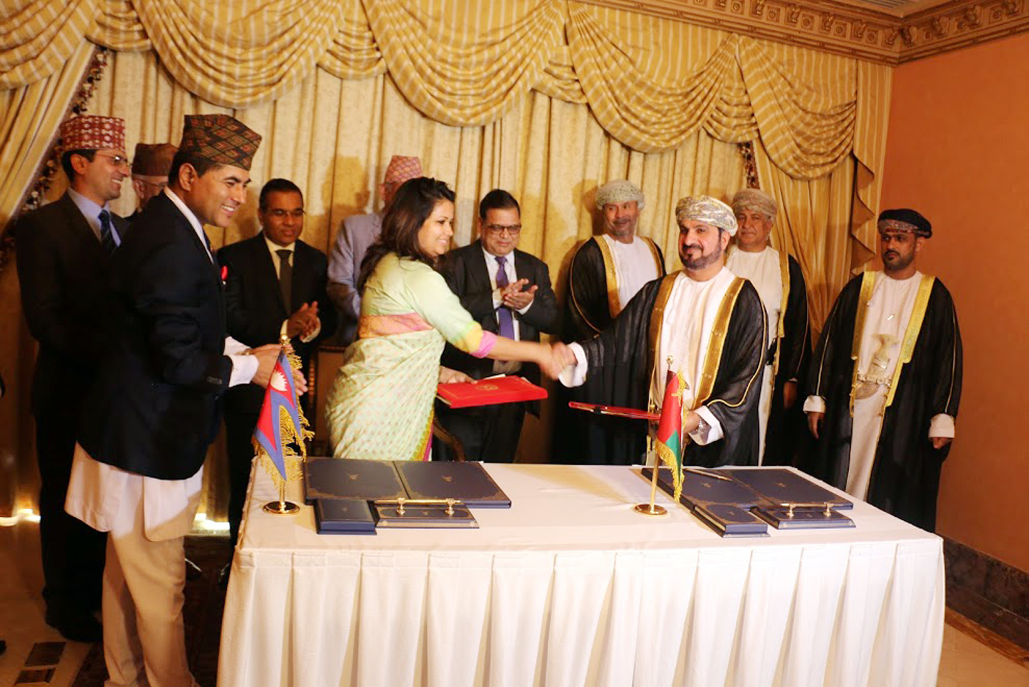 Ambassador of Nepal to Oman Sharmila Parajuli Dhakal (left) and Head of West Asia Department at the Ministry of Foreign Affairs of Oman, Shiekh Hilah Marhoon Al-Mammari exchange the MoU on behalf of the respective governments, in Oman, on Wednesday, September 27, 2017. Photo: RSS