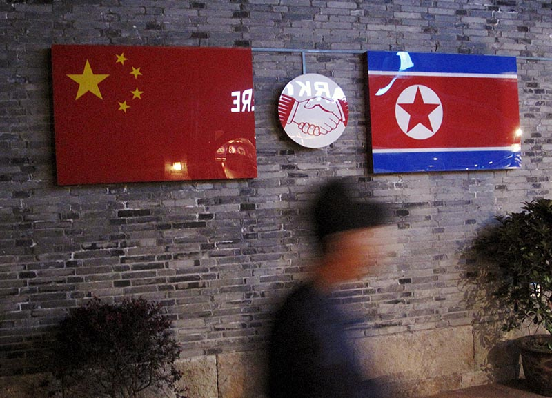 Flags of China and North Korea are seen outside the closed Ryugyong Korean Restaurant in Ningbo, Zhejiang province, China, on April 12, 2016.