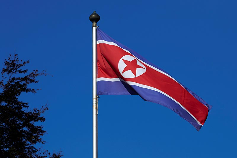 A North Korean flag flies on a mast at the Permanent Mission of North Korea in Geneva, on October 2, 2014.   Photo: Reuters