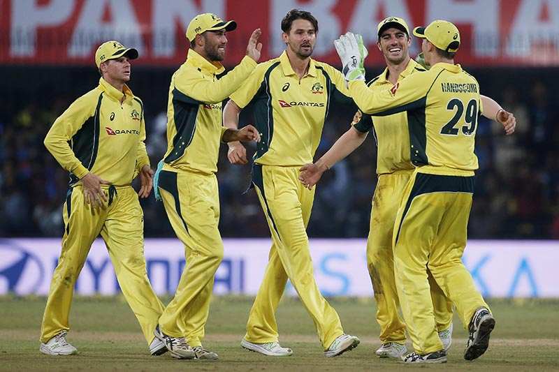 Australia's Kane Richardson (centre) celebrates with his team mates after dismissing India's Kedar Jadhav during the third one day international match between India and Australia, in Indore, India, on September 24, 2017. Photo: Reuters