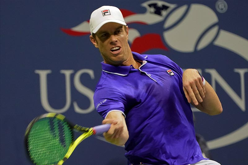 Sam Querrey of the United States in action against Mischa Zverev of Germany during their fourth round match. Photo: Reuters