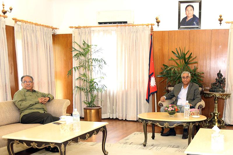 CPN-Maoist Cetre Chairman Pushpa Kamal Dahal meets Prime Minister Sher Bahadur Deuba at latter's official residence in Baluwatar, Kathmandu, on Sunday, September 17, 2017. Photo: RSS