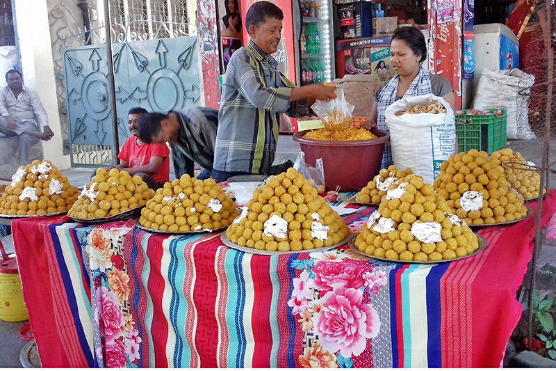 A customer buying sweet at Nayabazaar in Pokhara Lekhnath Metropolitan City on Wednesday, September 20, 2017. Photo: RSS