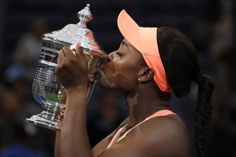 Sloane Stephens, of the United States, kisses the championship trophy after beating Madison Keys, of the United States, in the womenu2019s singles final of the US Open tennis tournament, in New York Saturday, September 9, 2017. Photo: AP