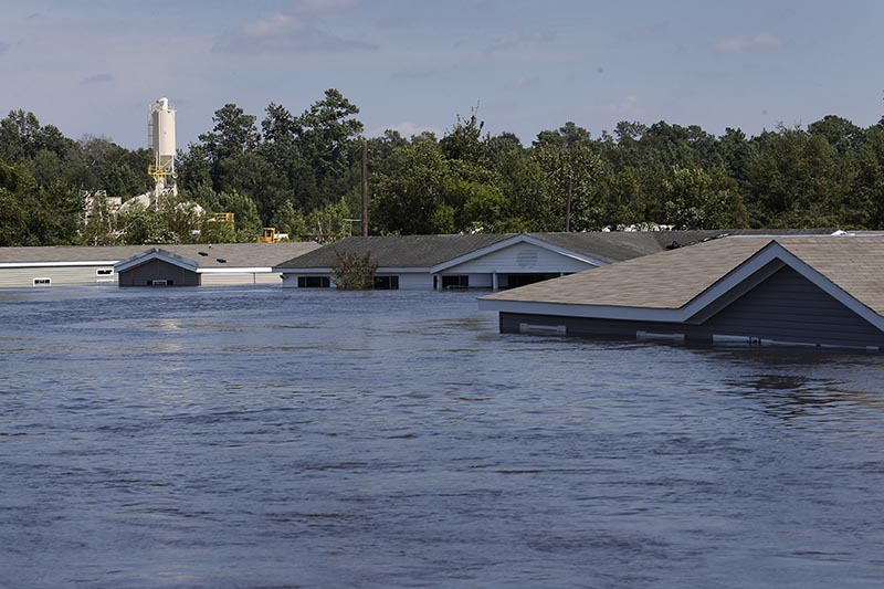 Submerged houses are seen by flood waters from Tropical Storm Harvey in Rose City, Texas, US, on August 31, 2017. Photo: Reuters
