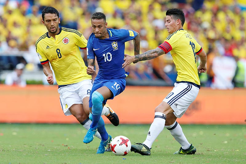 Neymar (10) of Brazil in action against Abel Aguilar (8) and James Rodriguez of Colombia in the 2018 World Cup Qualification match between Colombia and Brazil, at Metropolitano Roberto Melendez stadium, in Barranquilla, Colombia, on Septermber 5, 2017. Photo: Reuters