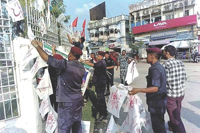 Police personnel removing election publicity materials, in Rajbiraj, on Friday, on Friday, September 15, 2017. Photo: THT