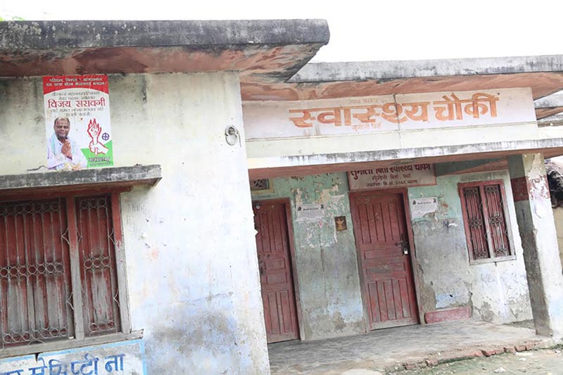 Federal Socialist Forum-Nepal violating the election code of conduct by pasting its poll poster on the wall of a health facility, in Birgunj, on Monday, September 4, 2017. Photo: THT