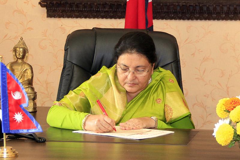 President Bidya Devi Bhandari certifies various bill at her office in Sheetal Niwas, Kathmandu, on Sunday, October 15, 2017. Courtesy: President's Office