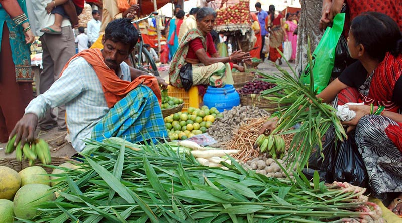 Street vendorts waiting for customers to sell vegetables on the eve of Chhath festival, in Birgunj, Parsa district, on Monday, October 23, 2017. Photo: Ram Sarraf