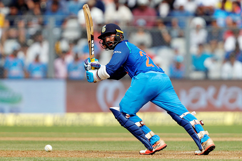 India's Dinesh Karthik plays a shot. Photo: Reuters