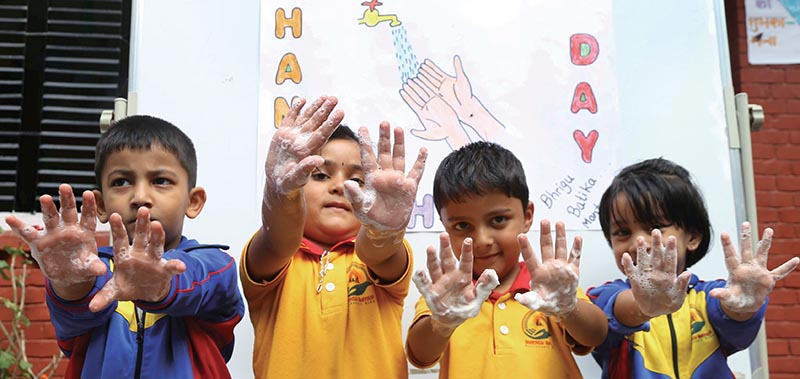 Children posing for a photo at a function held to mark Global Handwashing Day, in Kathmandu, on Sunday. Photo: THT