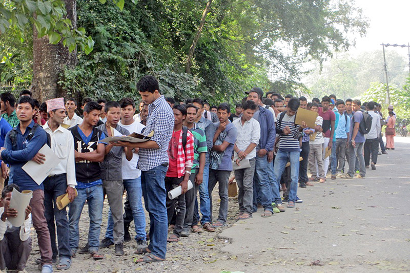Youth queuing up to submit their application for the vacant temporary police for upcoming elections at the Kanchandpur District Police Office in Mahendranagar, on Monday, October 16, 2017. Photo: RSS