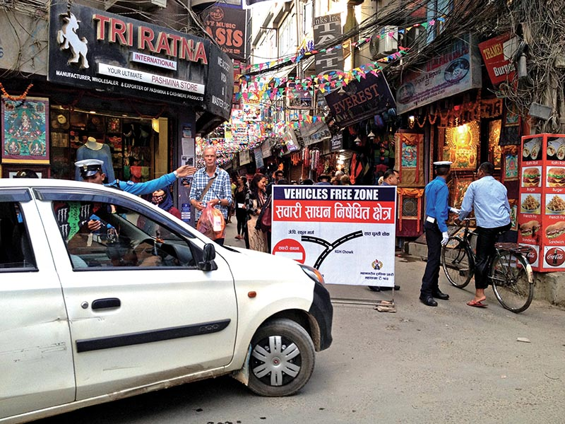 A traffic policeman showing a taxi driver a u2018no-gou2019 sign for vehicles in Thamel, Kathmandu, on Sunday, October 22, 2017. Photo: THT