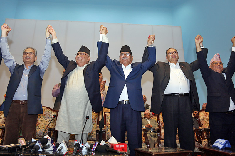Naya Shakti Party-Nepal Coordinator Baburam Bhattarai (second from left), CPN-UML Chair KP Sharma Oli (third from left), and CPN-Maoist Centre Chair Pushpa Kamal Dahal (fourth from left) raising hands after signing an agreement to forge electoral alliance among the three parties for the upcoming provincial and parliamentary elections, at City Hall, in Kathmandu, on Tuesday, October 3, 2017. Photo: RSS