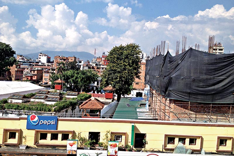 An under-construction business complex (right) in Basantapur Durbar Square, in Kathmandu, on Wednesday, October 11, 2017. Photo: THT