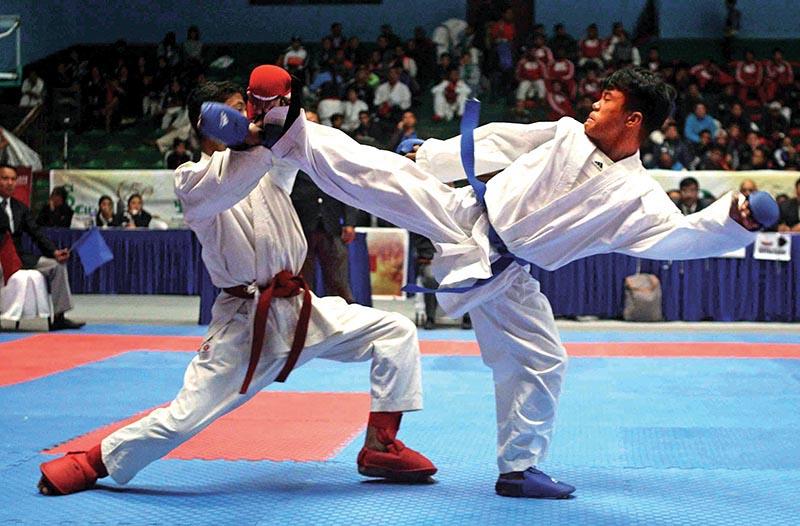 Balaram Adhikari (left) of Eastern Region fights against Dhan Kumar Rai of Western Region during their menu2019s 45kg bout of the 50th National Karate Championship at the NSC covered hall in Kathmandu on Thursday. Photo: Udipt Singh Chhetry / THT