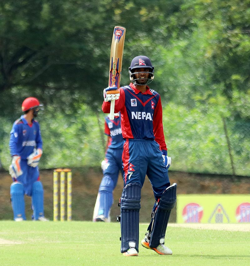 Nepalu2019s Anil Kumar Sah celebrates his half century against Afghanistan during their ACC U-19 Youth Asia Cup match at the Kinrara Oval in Kuala Lumpur on Friday, November 17, 2017. Photo Courtesy: NSJF