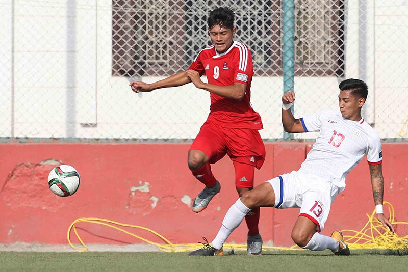 Nepalu2019s Bimal Gharti Magar (left) vies for the ball with a player from the Philippines during their AFC Asian Cup Qualifiers match in Lalitpur on Tuesday, November 14, 217. Photo: THT