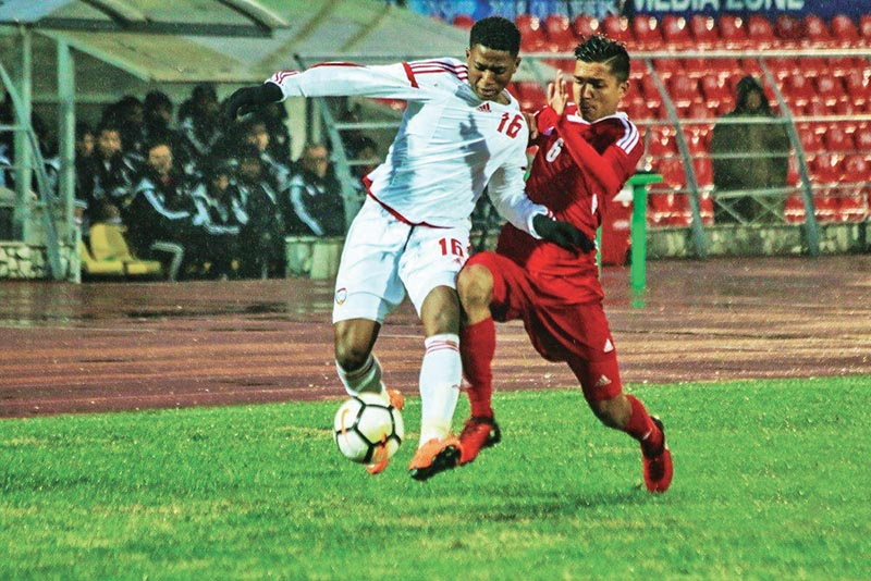 Nepalu2019s Suman Aryal (right) and UAEu2019s Abdulla Sayed Mohamed vie for the ball during their Group A match of the AFC U-19 Championship Qualifiers in Bishkek, Kyrgyzstan on Saturday. Photo Courtesy: FFKR