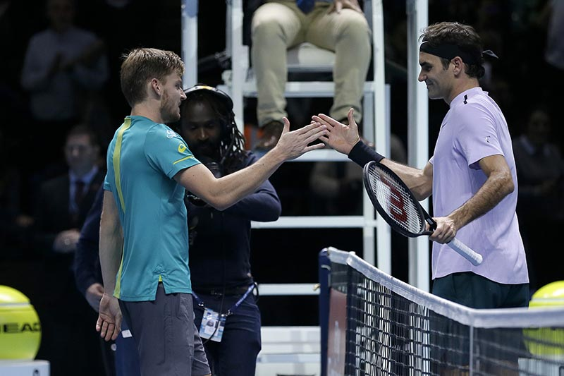David Goffin of Belgium, left, shakes hands with Roger Federer of Switzerland after Goffin won their ATP World Tour Finals semifinal tennis match at the O2 Arena in London, on Saturday November 18, 2017. Photo: AP