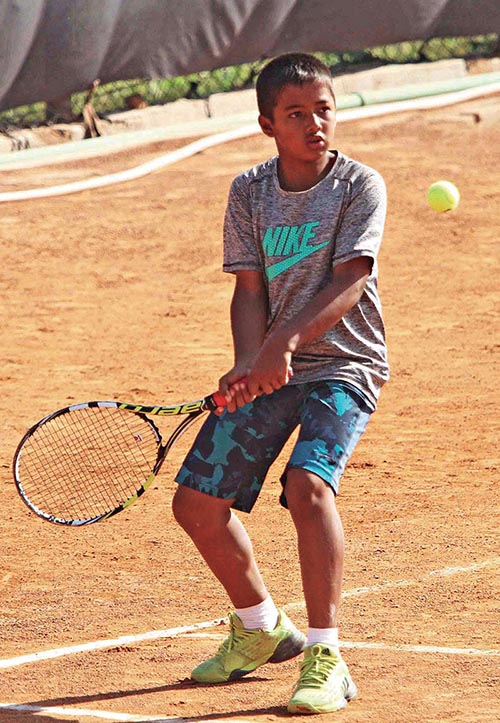 Aadit Subedi returns to Shreeyog Adhikari during their Kesha ANLTA Asian U-14 Ranking Championship Circuit-II match at the Satdobato Tennis Complex in Lalitpur on Tuesday. Photo: THT