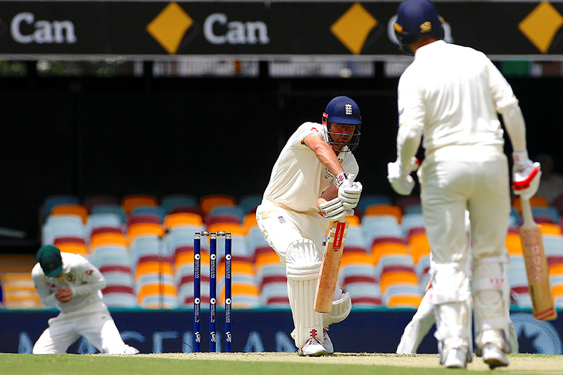 England's Alastair Cook is caught by Australia's Steve Smith, as England's Mark Stoneman looks on, during the first day of the first Ashes cricket test match. Photo: Reuters