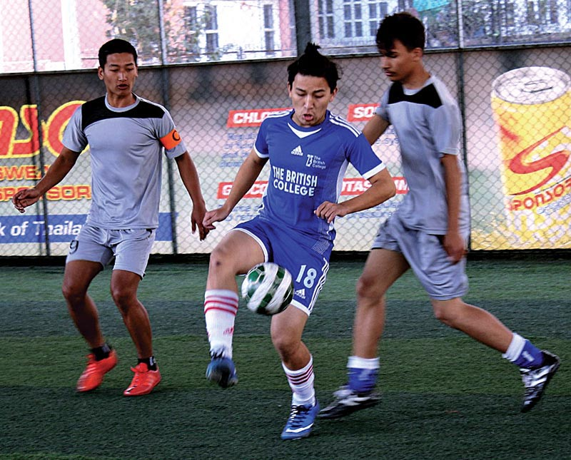 Players of Whitehouse and British College (legt) vie for the ball during their Alfa Beta Inter-college Futdal Tournament match in Kathmadu on Thursday. Photo: THT