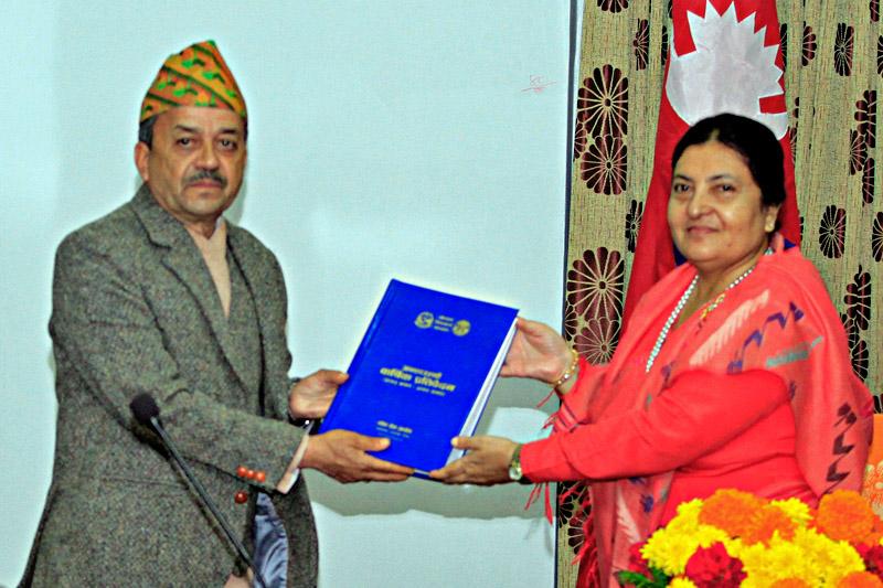 PSC Chairman Umesh Prasad Mainali submitting its annual report 2016/17 to the President Bidya Devi Bhandari at latter's office in Sheetal Niwas, Kathmandu, on Friday, November 24, 2017. Courtesy: President's Office